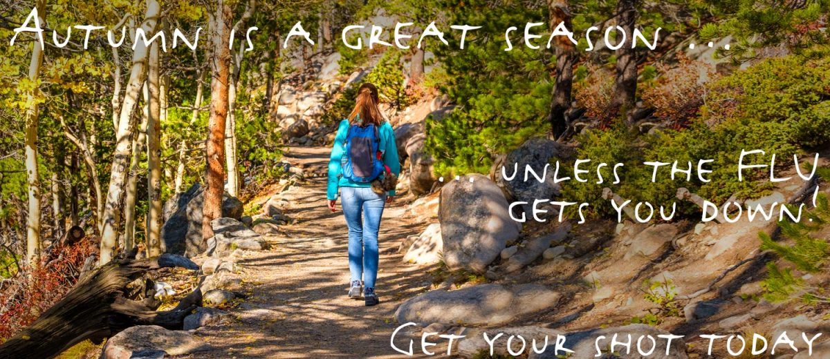 Woman walking in the woods in fall. Text: Autumn is a great season … unless the FLU gets you down! Get your shot today
