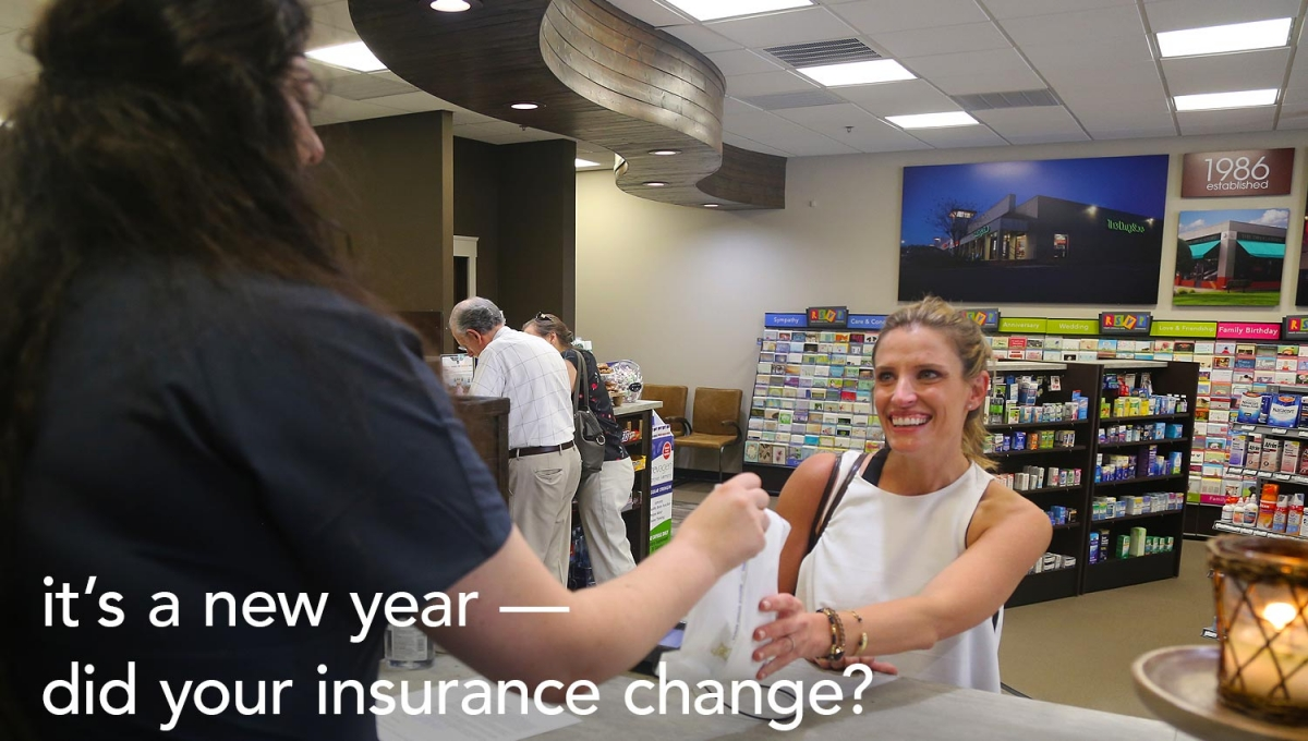 The Drug Store - woman at counter picking up her prescription - text: it's a new year - did your insurance change?
