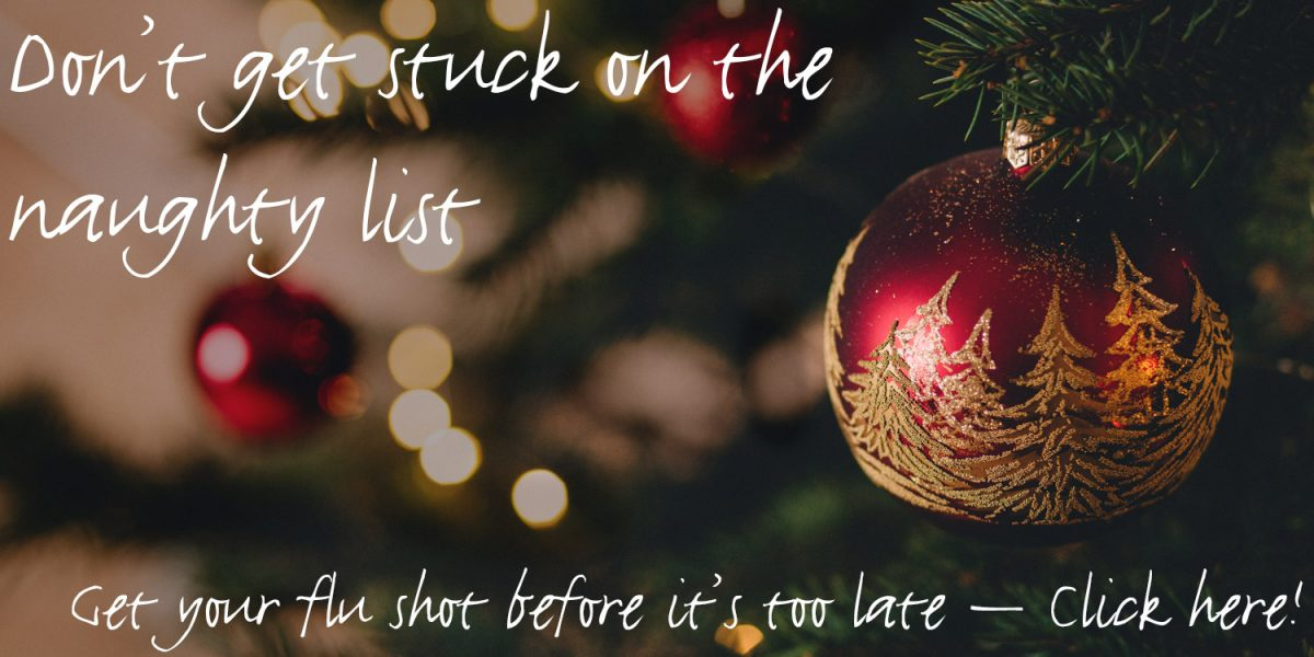"""Text """"Don't get stuck on the naughty list - Get your flu shot before it's too late - click here!"""" over a closeup of Christmas ball ornament on a Christmas tree"""