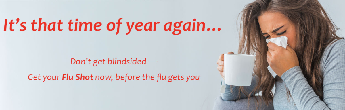 "Woman with tissue and cup, text ""It's that time of year again… Don't get blindsided - get your flu shot now, before the flu gets you"""